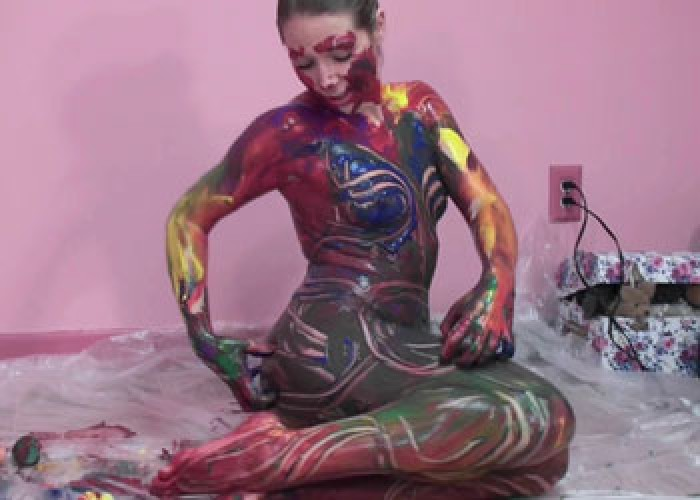 Kinky coed Lina is covered in paint